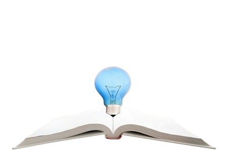 blank magic book with reading light bulb photo