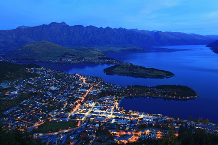 aerial view of Queenstown at dusk with the remakable range and lake wakatipu background  photo