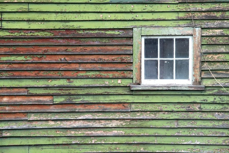 old grunge green wooden panel with glass windows photo