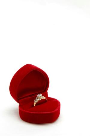 isolated female diamond ring in red velvet box photo