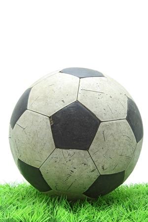 grunge soccer football on green grass photo