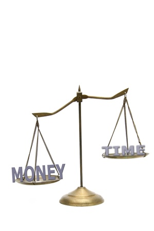 money is greater than time concept on golden brass scales photo