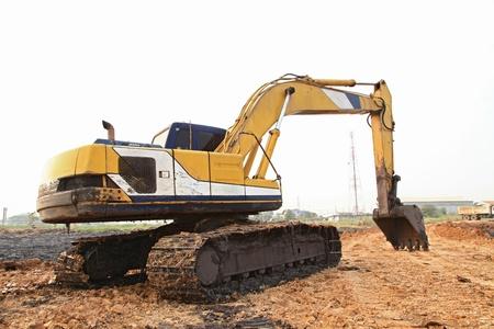 Excavator Loader with backhoe standing in sandpit photo