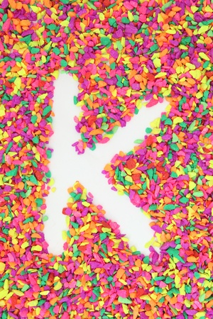 The letter K alphabet and font made of colorful rock stone photo