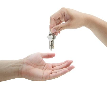 man handing over the set of keys house photo