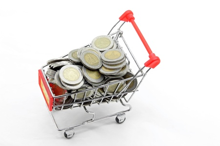 shopping cart with full load of wealth coins money inside photo