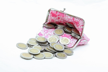 isolated of wealth coins spilling from money bag Stock Photo - 9451516