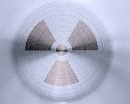 grunge nuclear sign on metal texture background photo