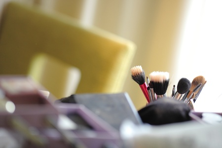 perspective of cosmetic brushes in cup white photo