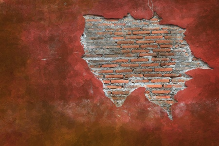 Cracking grunge weathered vintage and fragment of Red brick wall using as background photo