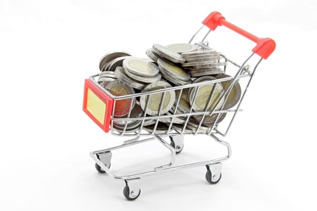 studio shot of shopping cart with full wealth coins inside isolated on white background Stock Photo - 9599472
