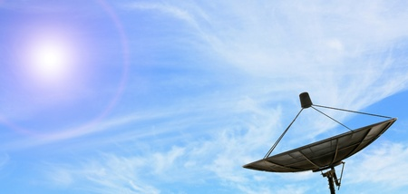 satellite tv: conceptual of black antenna communication satellite dish over sunny blue sky Stock Photo