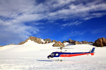franz: Helicopter landing on top of Franz Josef Glacier mount cook in New Zealand.