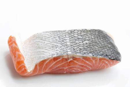 studio shot of raw salmon fillet isolated on dish photo