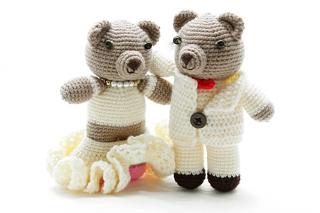 playthings: couples of bride and groom bears getting married isolated on white