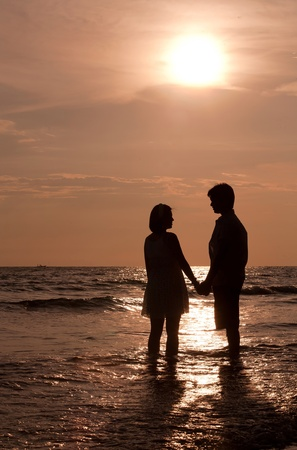 romantic couples: romantic and happiness scene of couples on the Beach Stock Photo