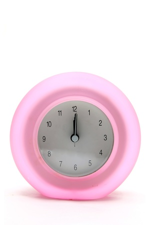 pink round modern alarm clock front perspective photo