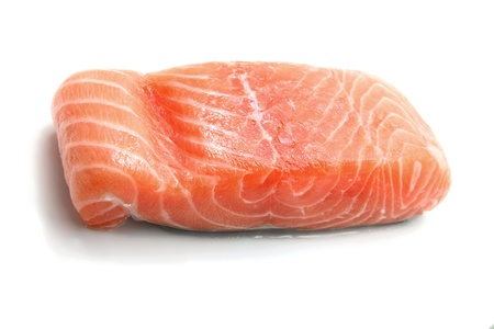 raw salmon fillet isolated on white background photo