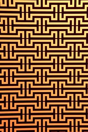widows steel rod pattern on orange, close up Stock Photo - 9811874