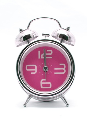 pink alarm clock front perspective photo