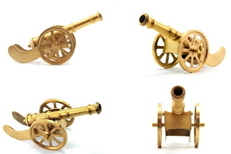 artillery: collection of golden metal cannon antique isolated on white background