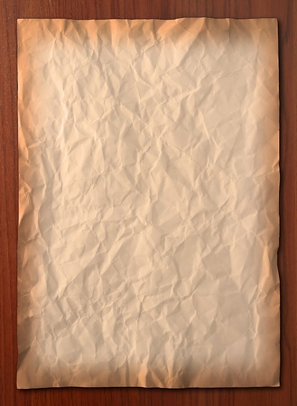 Wrinkled vintage paper on wooden board, Vertical photo