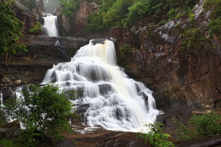 tropical rain forest waterfall in jungle of Thailand landscpae photo
