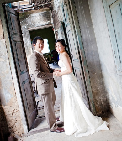 couples of groom and bride portrait in old church after wedding ceremony photo