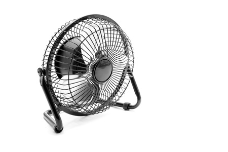 Metal portable fan isolated on the white background photo