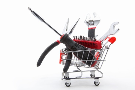 collection of construction tools and equipment inside a shopping cart