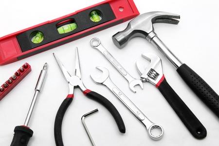 basic construction tool set on white background photo