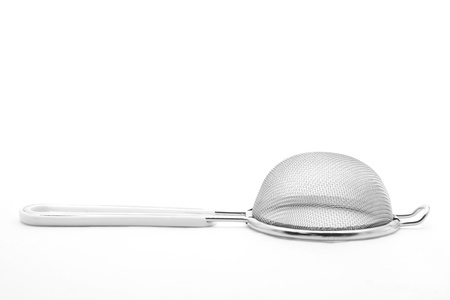 Kitchen sieve utensil equipment isolated on white photo