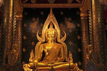 golden buddha statue image in Phisanulok Temple Thailand photo