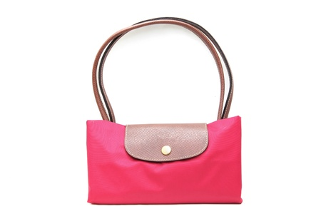 fashion pink fake leather woman bag on white background Stock Photo - 10037739