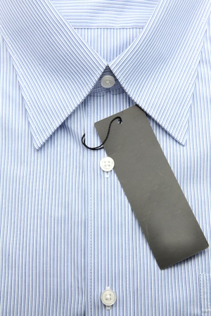 Close up view of a generic line pattern blue business shirt with a blank label photo