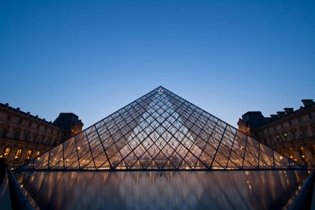 louvre pyramid: France PARIS-APRIL 16,2010: Silhouette of Louvre pyramid at Evening during the Summer Antiquities Exhibition April 16, 2010.Louvre is the biggest Museum in Paris displayed over 60,000 square meters of exhibition space. Editorial