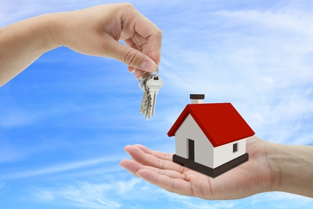 property owners: concept of buying house property with blue sky background