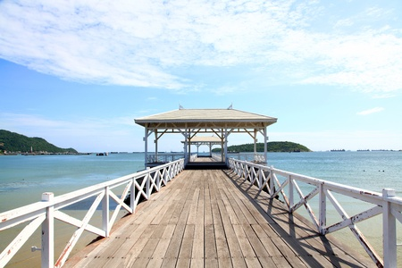pavillion: wooden jetty walkway with pavillion to the sea at Srichang Island Thailand with blue sky