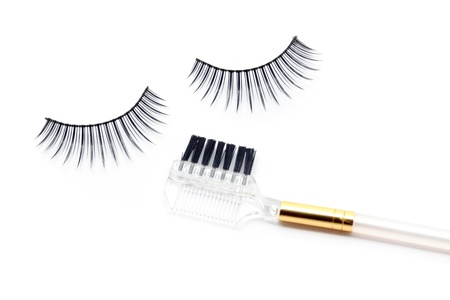 False eyelash mascara and make-up brush isolated on white  photo