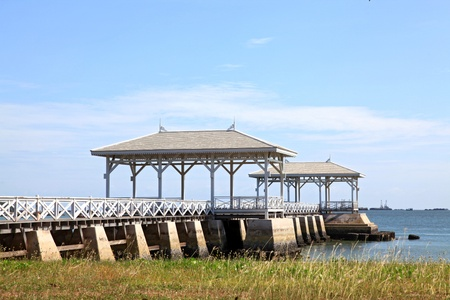 pavillion: wooden jetty walkway with royal pavillion to the sea at Srichang Island Thailand with blue sky