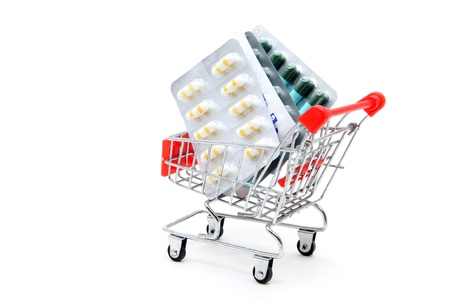 Capsules in shopping cart trolley for healthy concept photo