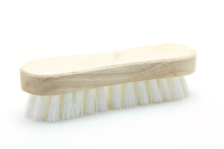 wooden cleaning scrub brush isolated on white background photo