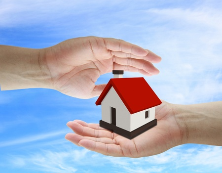 asian business man holding house for insurance concept Stock Photo - 10223669
