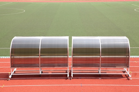 game reserve: Coach and reserve benches in football soccer stadium