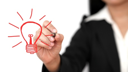 new ideas: Asian business woman drawing light bulb for creativity concept
