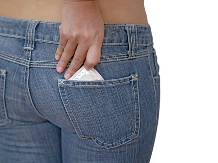 safe sex: Pulling out condoms of jean pocket for Safe Sex concept. Stock Photo