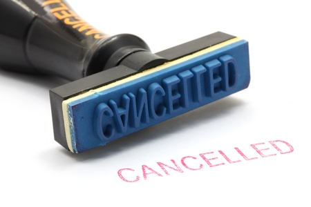 deny: closeup of cancelled letter on rubber stamp isolated on white background