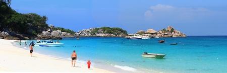 similan islands: traveller walking on white sand beach at Similan island national park Andaman Thailand