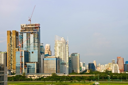 Skyscraper Office Tower  in Bangkok Thailand with green diving range photo