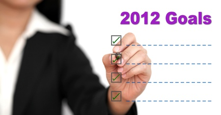 Asian business woman writing 2012 Goal List Stock Photo - 10324150